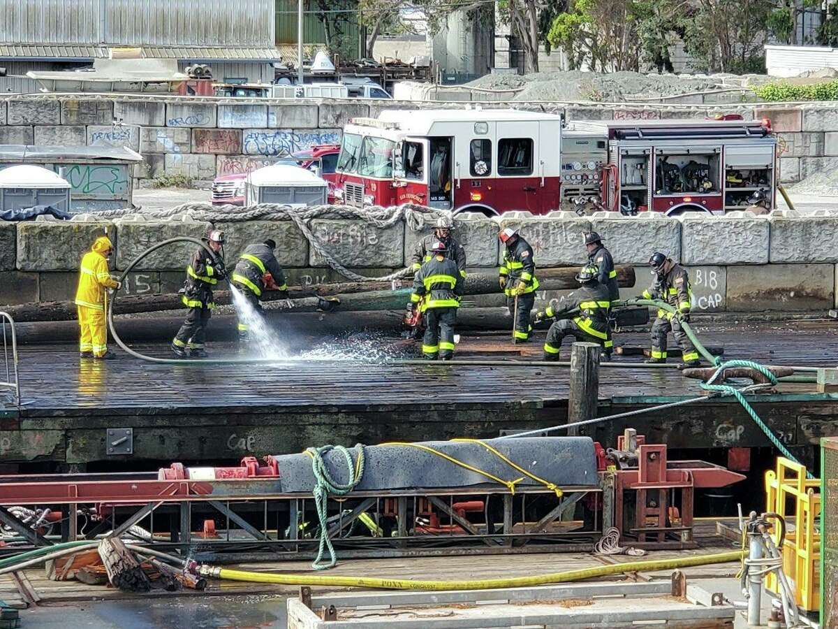 The San Francisco Fire Department respond to a pier fire caused by fireworks at 450 Amador St. on Monday morning.