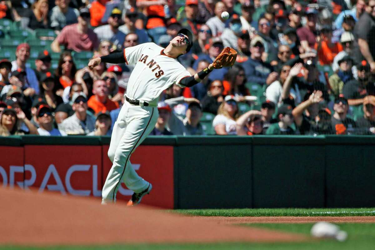 San Francisco Giants third baseman Wilmer Flores (41) makes the out on a pop-up in the first inning during an MLB game against the St. Louis Cardinals at Oracle Park, Monday, July 5, 2021, in San Francisco, Calif.