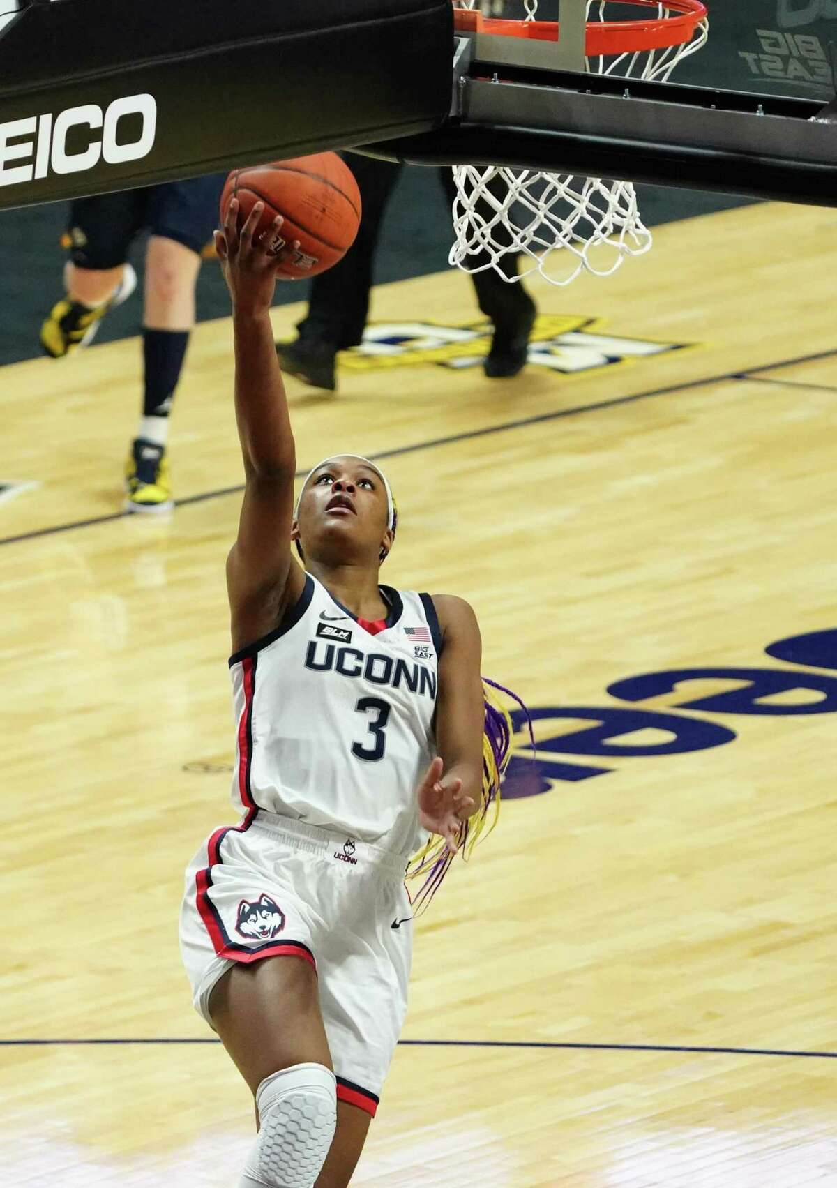 UConn Huskies forward Aaliyah Edwards (3) drives to the basket against the Marquette Golden Eagles in the first half at Mohegan Sun.