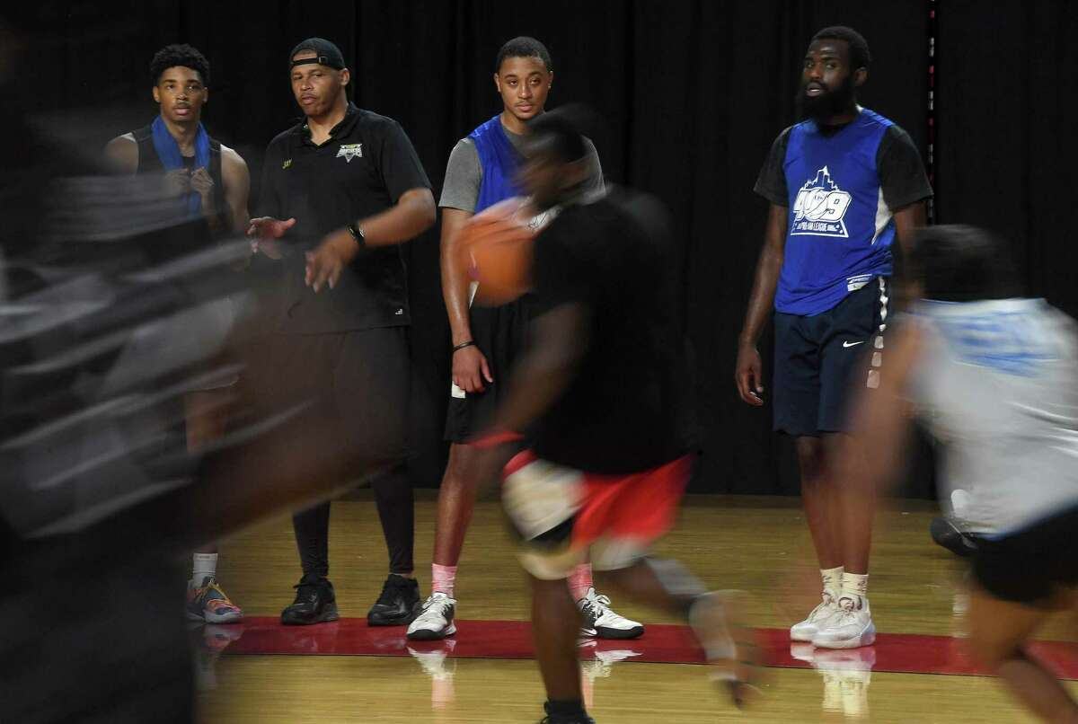 Panther hopefuls, including Lamar graduate T.J. Atwood (second from right), observe as others play during the first day of tryouts for the Beaumont Panthers, a professional basketball team spearheaded by former NBA player and Southeast Texas native Kendrick Perkins. It was an idea born out of a conversation with new Beaumont City Councilman A.J. Turner, who spoke to the need for young people especially to have a point of pride in their community. Tryouts continued Sunday at the Montagne Center, with a second two-day round of tryouts scheduled in November. The team's game season is set to begin next spring. Photo made Saturday, July 3, 2021 Kim Brent/The Enterprise