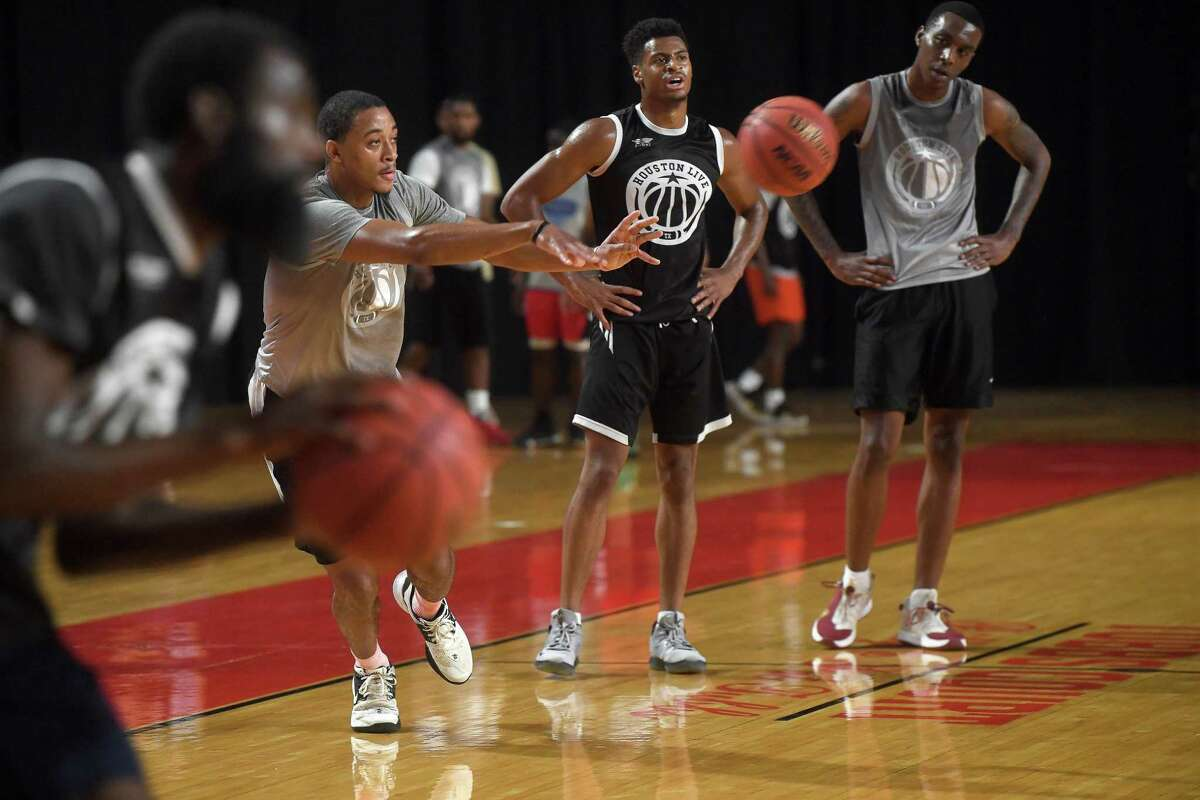 Local players, including Lamar's T.J. Atwood (passing at left), run drills during the first day of tryouts for the Beaumont Panthers, a professional basketball team spearheaded by former NBA player and Southeast Texas native Kendrick Perkins. It was an idea born out of a conversation with new Beaumont City Councilman A.J. Turner, who spoke to the need for young people especially to have a point of pride in their community. Tryouts continued Sunday at the Montagne Center, with a second two-day round of tryouts scheduled in November. The team's game season is set to begin next spring. Photo made Saturday, July 3, 2021 Kim Brent/The Enterprise