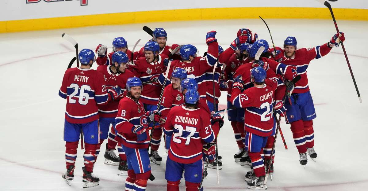 The Montreal Canadiens celebrate their 3-2 win during the first overtime period against the Tampa Bay Lightning in Game Four of the 2021 NHL Stanley Cup Final at the Bell Centre on July 05, 2021 in Montreal, Quebec, Canada. (Photo by Mark Blinch/Getty Images)