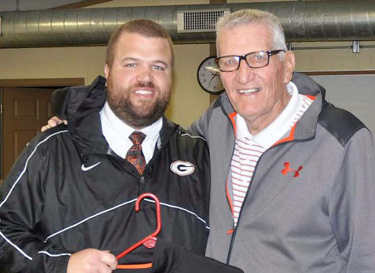 Longtime Gillespie football coach Don Dobrino (right) poses with current Miners coach Jake Bilbruck. Dobrino ended his 53-year coaching career as an assistant on Bilbruck's staff.