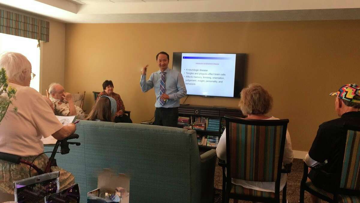 Dr. Fei Sun presents training on financial abuse of vulnerable adults. (Courtesy photo)