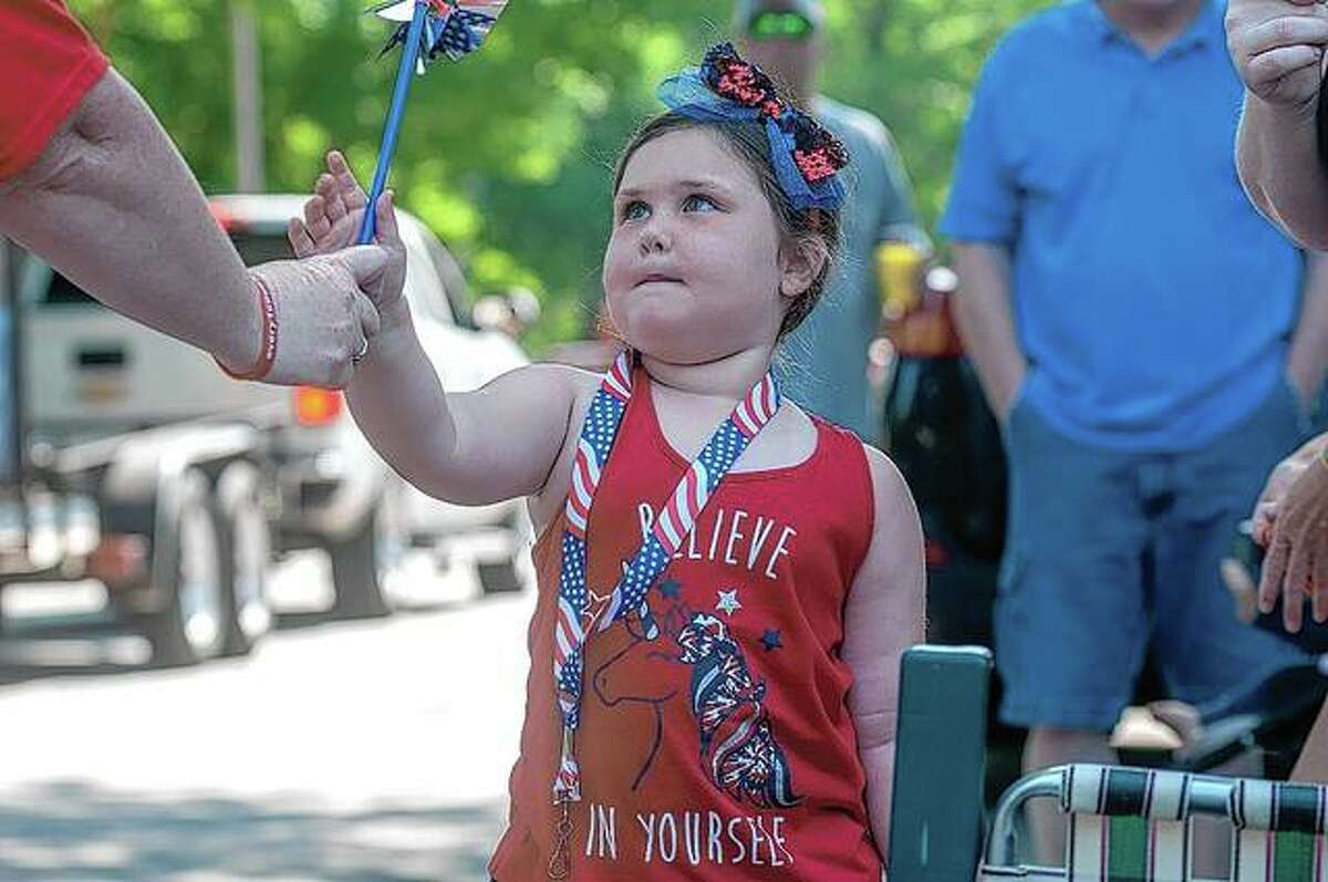 After 18 months of pandemic restrictions, communities across the region this weekend rang in the first holiday since crowds were allowed to gather. During the Jacksonville Rotary Club's July Fourth Parade, Makenna Kaufmann, 4, enjoyed the marchers making their way along State Street. (More photos from the parade available at myjournalcourier.com)
