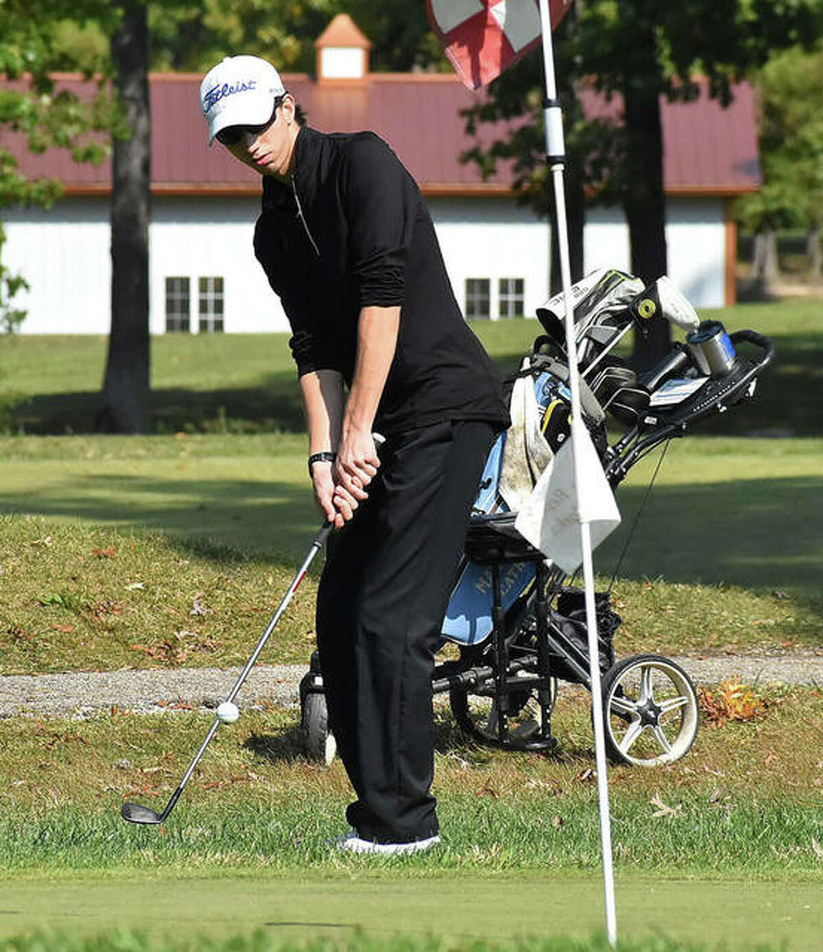 Marquette's William Roderfeld chips onto the green at the Class 1A regional at Timber Lakes in Staunton. Roderfeld shot 77 to place fourth in the regional.