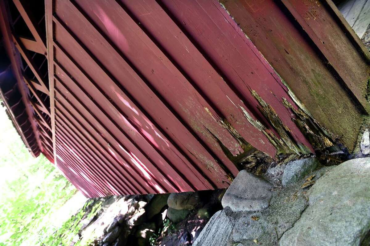 Rotting wood is visible on the covered bridge in Chatfield Hollow State Park in Killingworth on June 30.