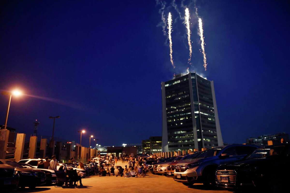 Fireworks launched from atop the Landmark Tower light up the sky in Stamford, Conn. Monday, July 5, 2021. The Fourth of July fireworks show, presented by the Stamford Downtown Special Services District, went on Monday night after being initially postponed due to inclement weather.