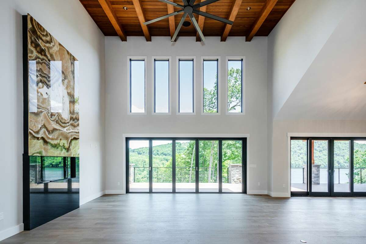 The great room has 20-foot cathedral ceilings, as well as a wood ceiling with exposed beams. View listing