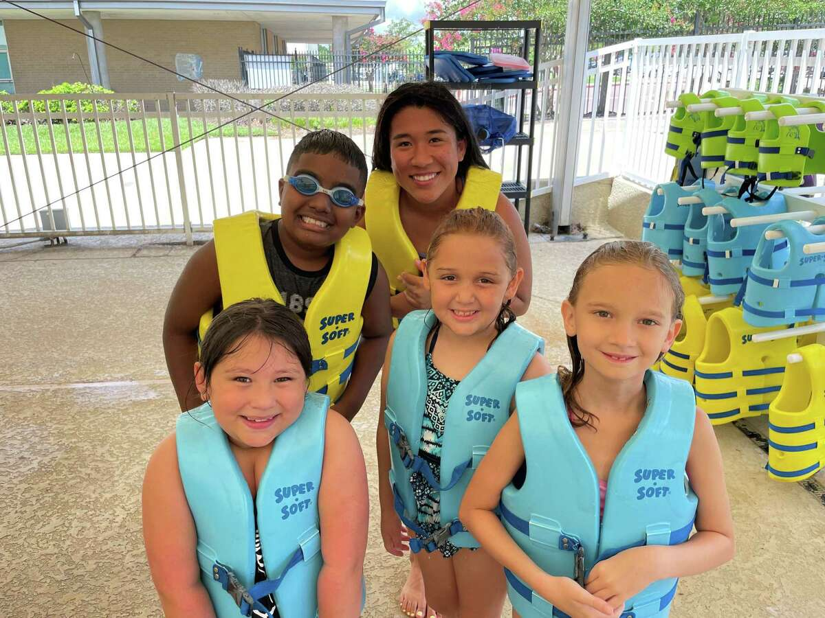 Participants of the City of Conroe's Learn to Swim program. The Conroe Aquatic Center offers individualized instruction designed to help participants to improve existing skills or overcome fear in the water.