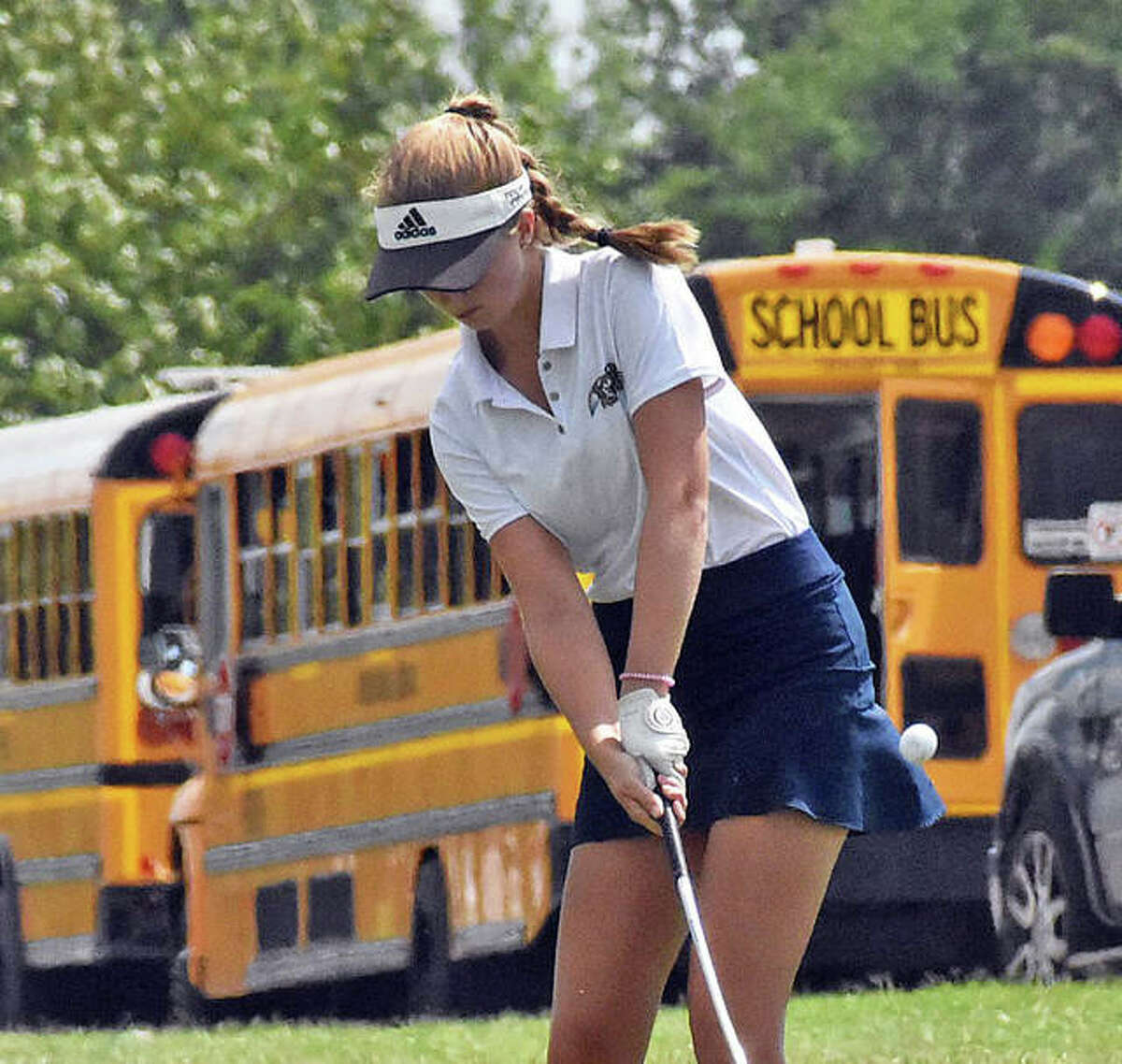 Father McGivney's Ellie Hyten chips a shot onto the green during the Madison County Tournament at Legacy Golf Course in Granite City.