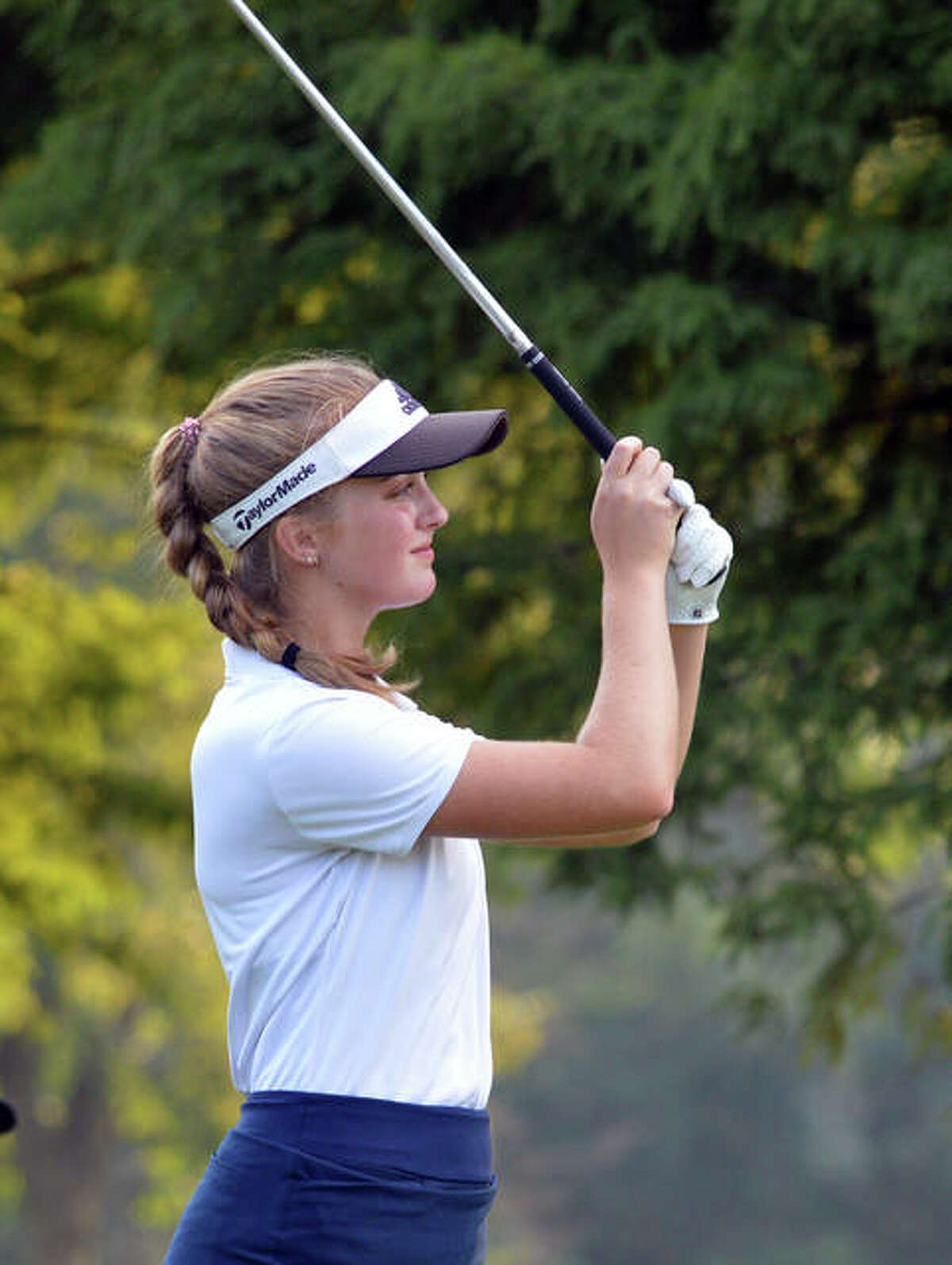 Father McGivney's Ellie Hyten watches her approach shot during an event this past season.