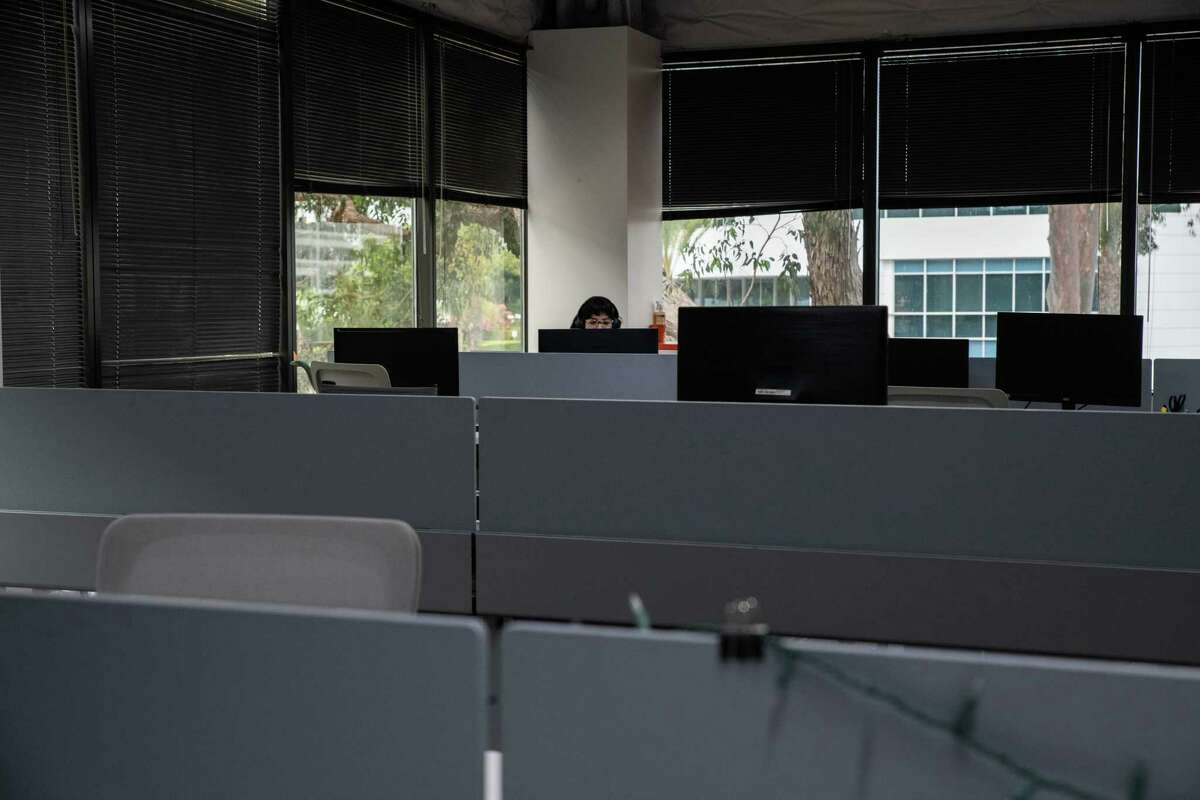 Stephanie Port works in a near-empty corner at Wpromote's office. Port is one of the employees choosing to return to in-person work.