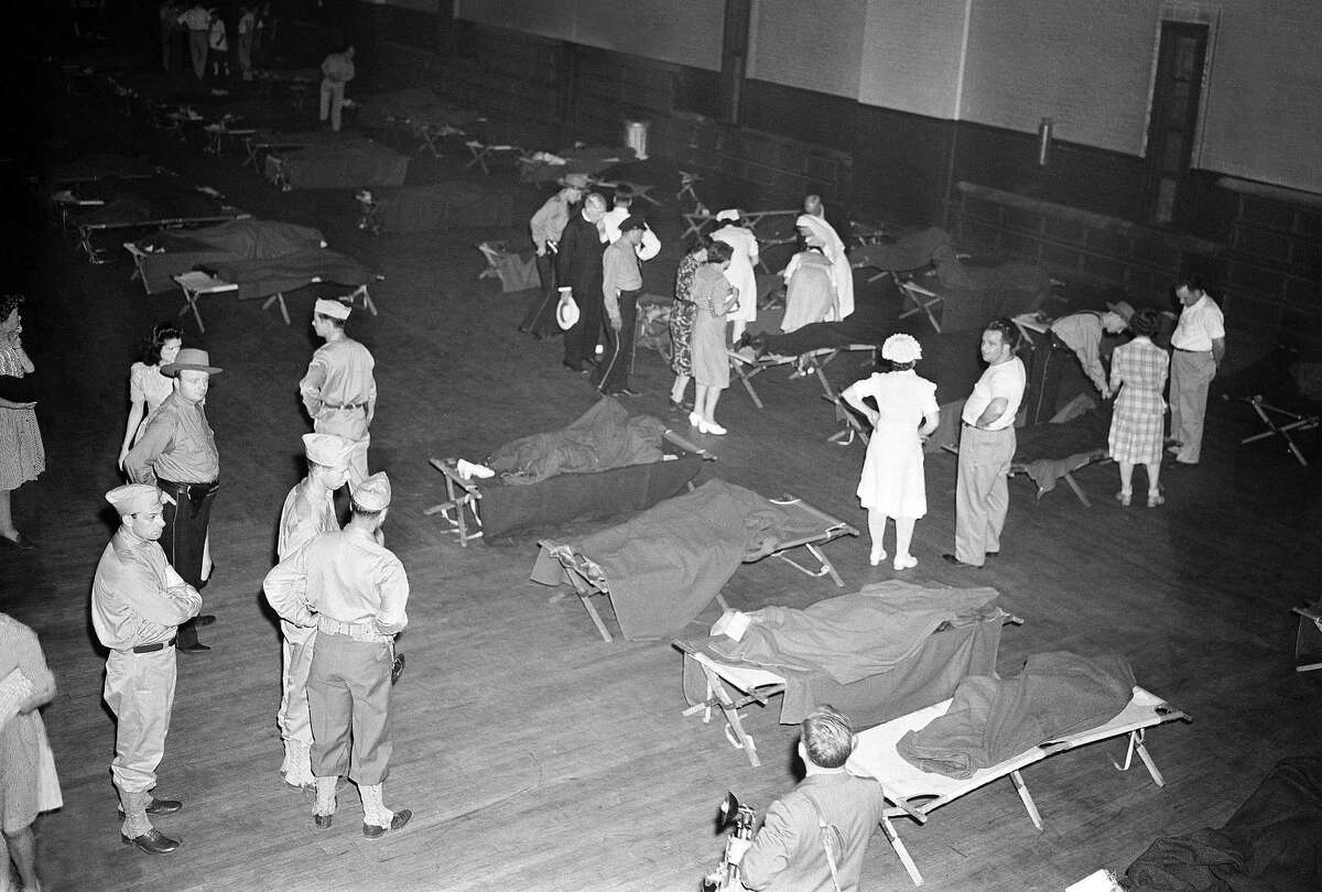 This July 6, 1944, file photo shows a scene at the armory where bodies were brought in the aftermath of a fatal circus fire in Hartford, Conn.