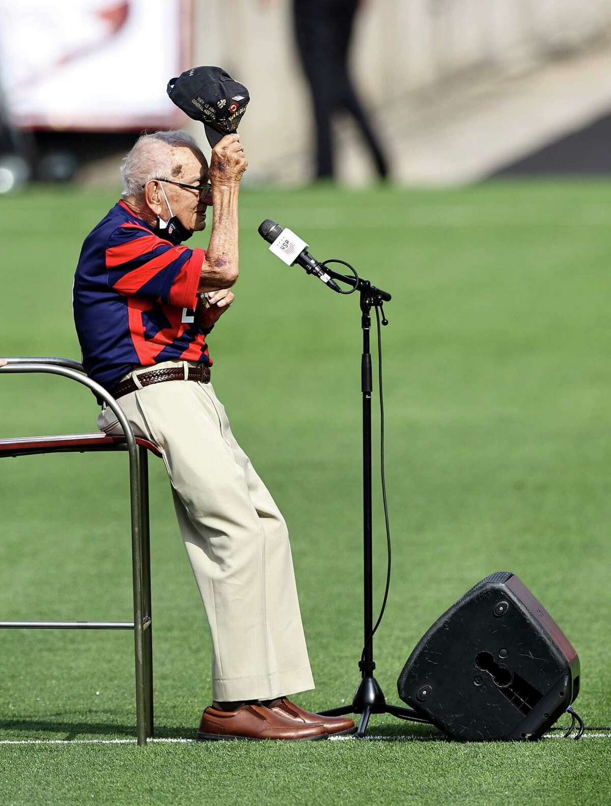 """""""Harmonica Pete"""" DuPre salutes the fans after he performed the national anthem of the United States before the Send Off series match between the United States and Mexico at Pratt & Whitney Stadium at Rentschler Field on July 05, 2021 in East Hartford, Connecticut."""