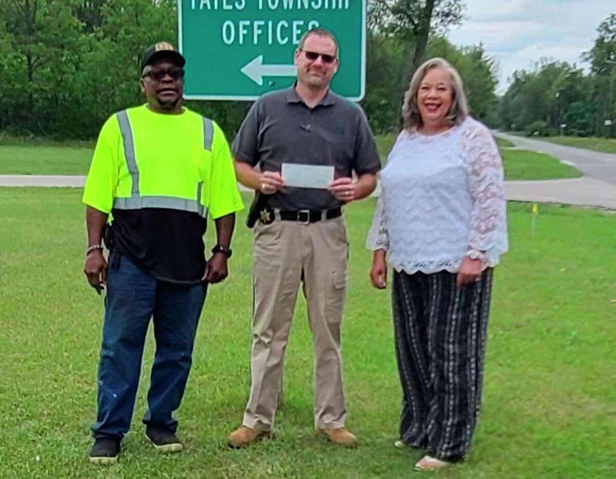 Sheriff Rich Martin (center) presented Yates Township officials with a donation of $2,000 from the Sheriff's Department Charities recently. (Submitted photo)
