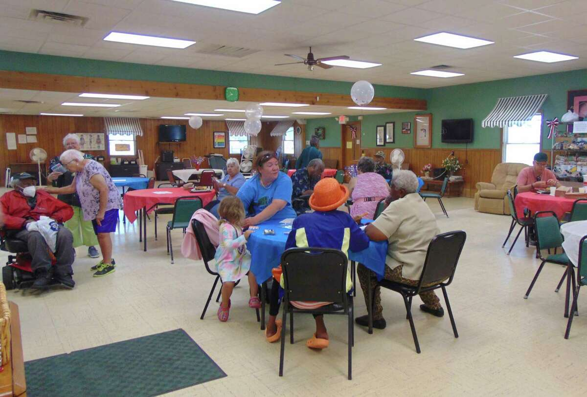 Friends and community members enjoyed a picnic lunch while catching up with another after a year of the center being closed due to COVID restrictions. (Star photo/Shanna Avery)