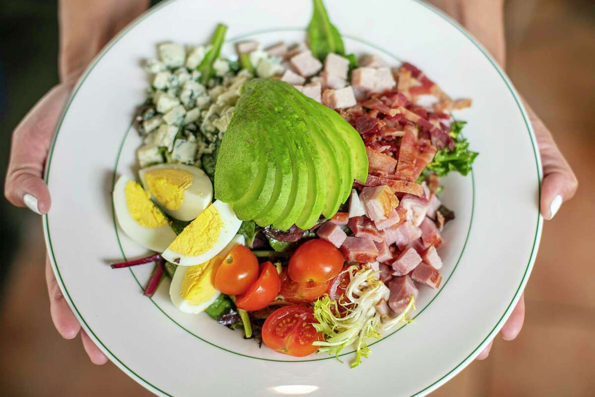 """""""I wanted to be a part of (Asian Restaurant Month) even though I'm more of an American style restaurant,"""" said Kerry Paul, also known as KP. Cobb salad at KP's Kitchen, a new American Bistro at 700 Town and Country Blvd. in Memorial neighborhood."""