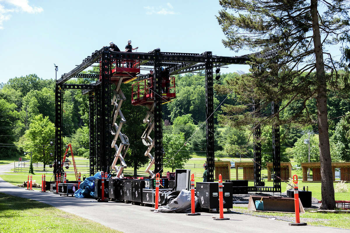 Workers build the outdoor stage at Glimmerglass earlier this summer. (Karli Cadel/The Glimmerglass Festival)