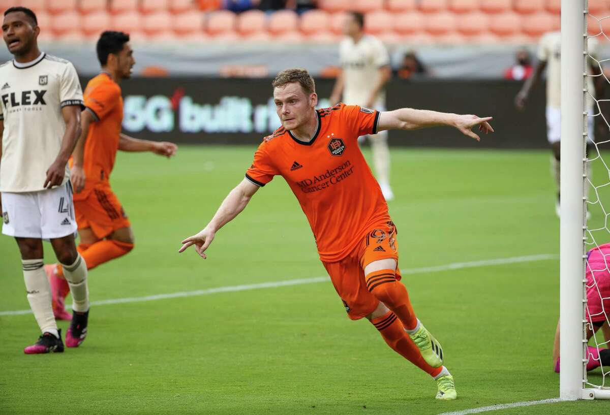 The Dynamo will be without forward Tyler Pasher, celebrating a goal against LA FC earlier this season, after he was called up to Canada's national team for the Gold Cup.