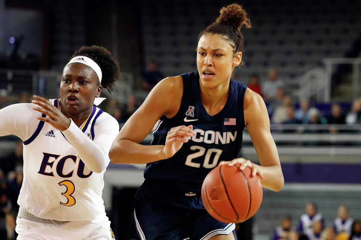 Connecticut's Olivia Nelson-Ododa (20) drives the ball past East Carolina's Xianna Josephs (3) during the second half of an NCAA college basketball game, Saturday, Jan. 25, 2020 in Greenville, N.C. (AP Photo/Karl B DeBlaker)