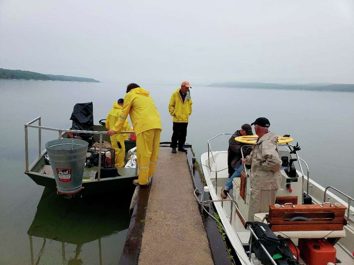 Clear Water Lake Management and Zero Gravity Aerial prepare to treat Eurasian watermilfoil infestations in Crystal Lake with herbicide. (Courtesy Photo)