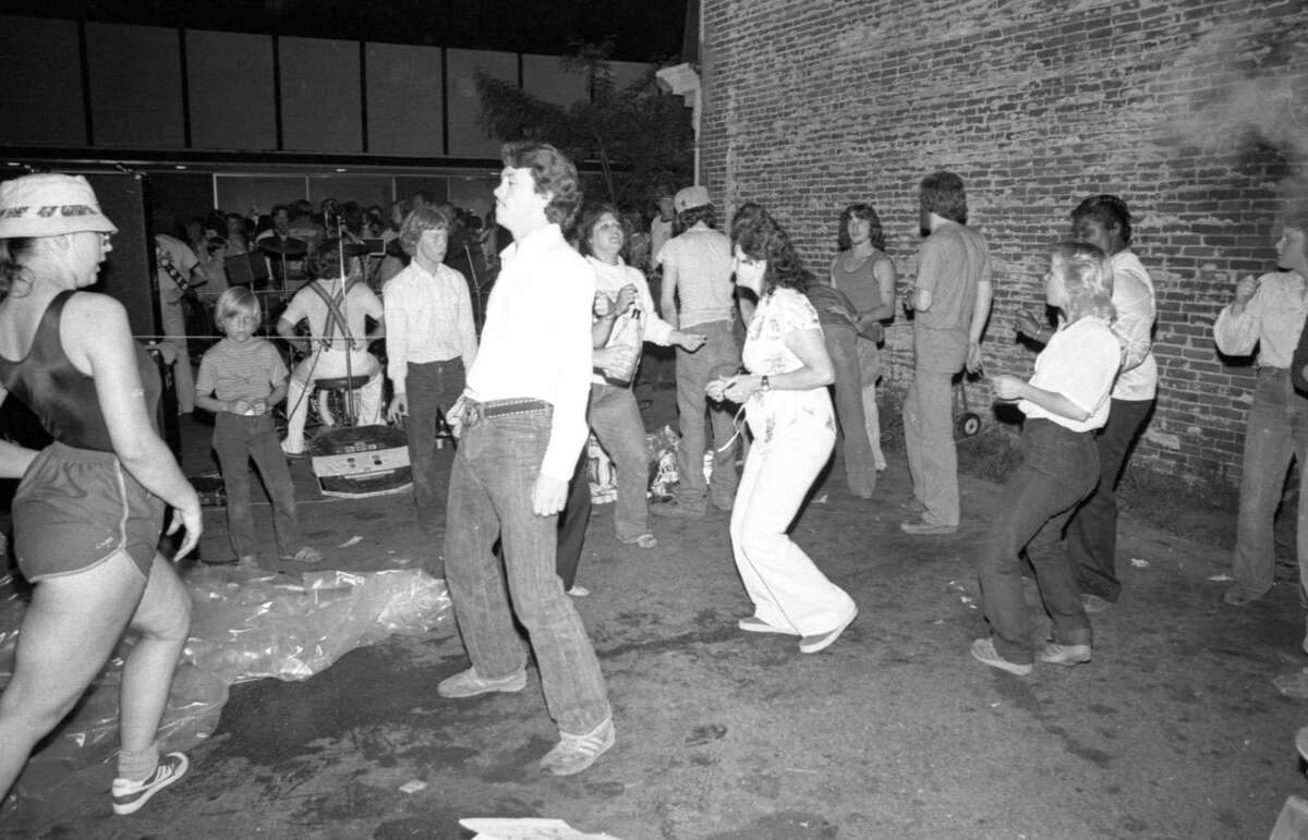 River Street was a hopping place during the Manistee National Forest Festival as people danced the night away during the street dance that took place in early July 1981. (Manistee County Historical Museum photo)