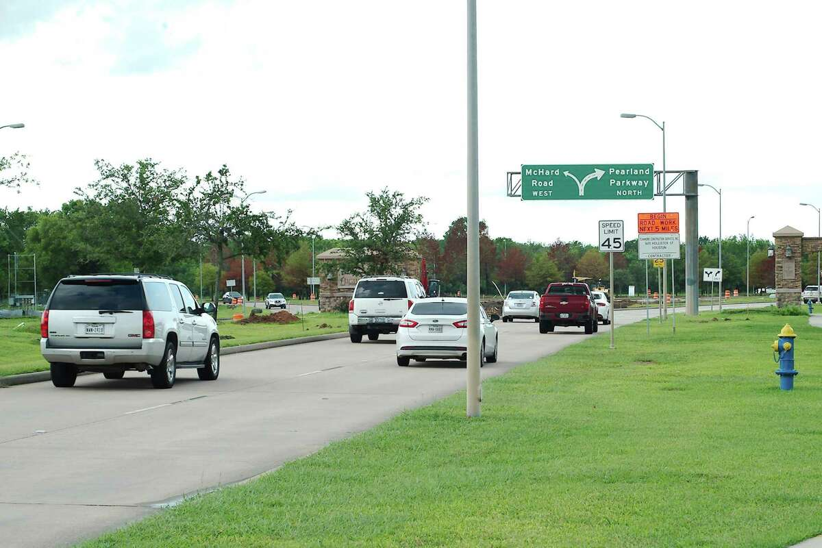 Vehicles travel north on Pearland Parkway toward the roundabout under construction at McHard Road. The intersection will see more traffic from McHard once a $45 million, 3.5-mile extension of that road between Cullen Parkway and Mykawa is completed next fall, after completion of the roundabout.