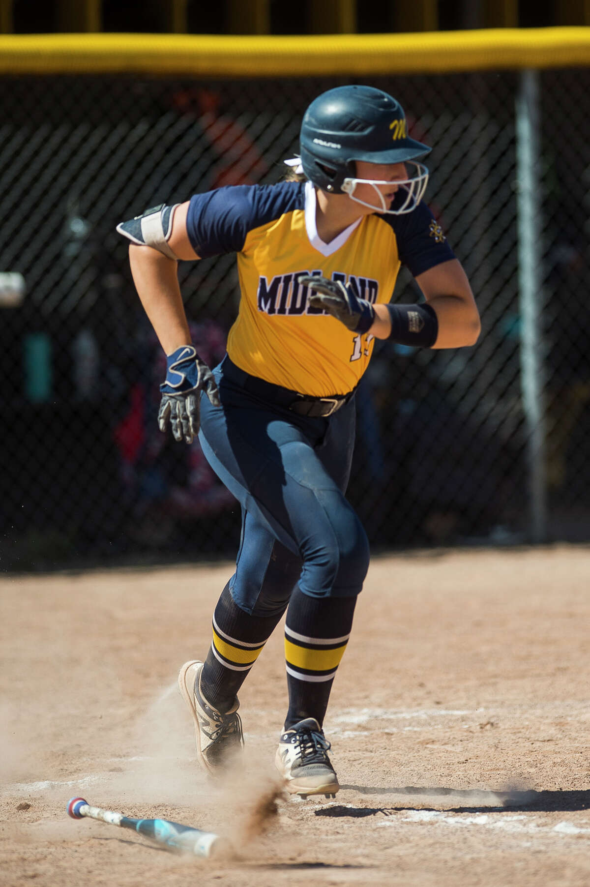 Midland High's Taylor Sanborn heads to first during a June 5, 2021 district semifinal against Dow High.