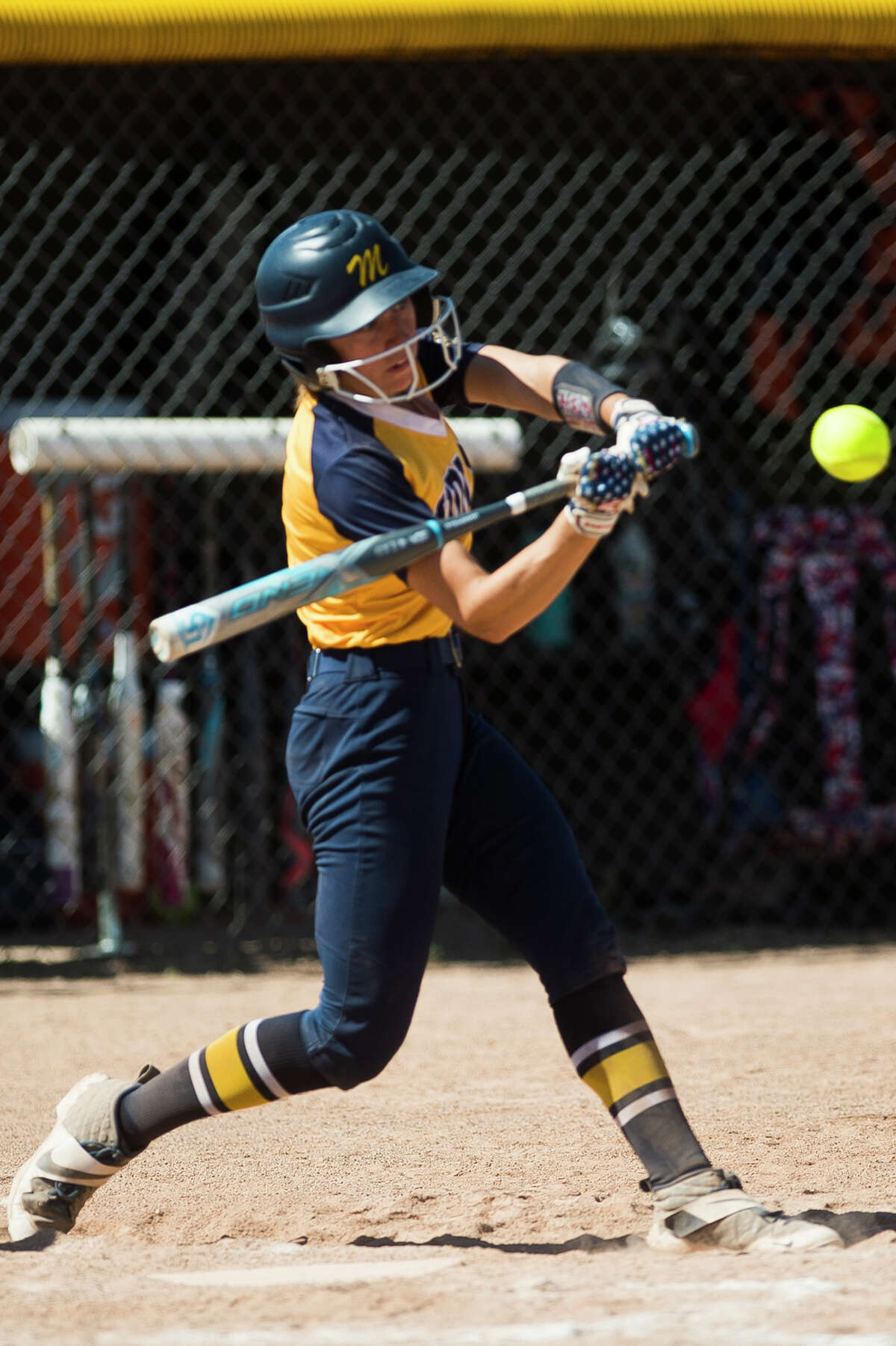 Midland's Gabby Schloop takes a swing during a June 5, 2021 district semifinal against Dow High.