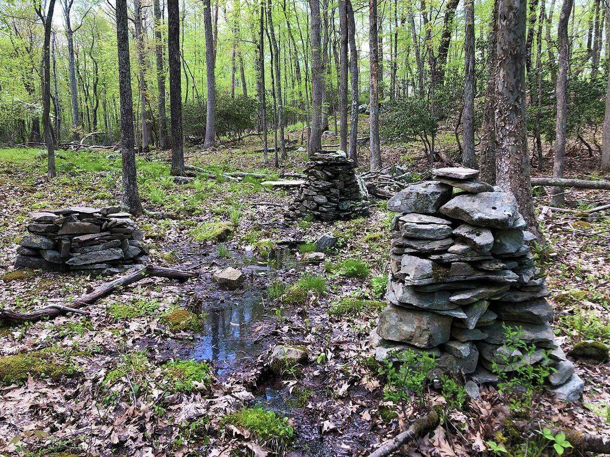 A trio of mysterious stone structures along the Ravine Trail.