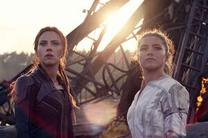 """""""Black Widow"""" (Scarlett Johansson) and her on-screen sister/fellow Oscar nominee (Florence Pugh) do everything male superheroes do, only (metaphorically) backwards and in heels."""