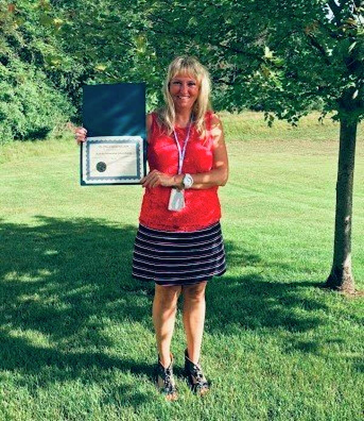 Brooke McIsaac, Manistee Intermediate School District special education director, holdsthe Seal of Achievement received from Michigan Department of Education. The MISD received a 100% scorefor compliance indicators in the status determinations process for the 2020-21 school year. (Courtesy photo)