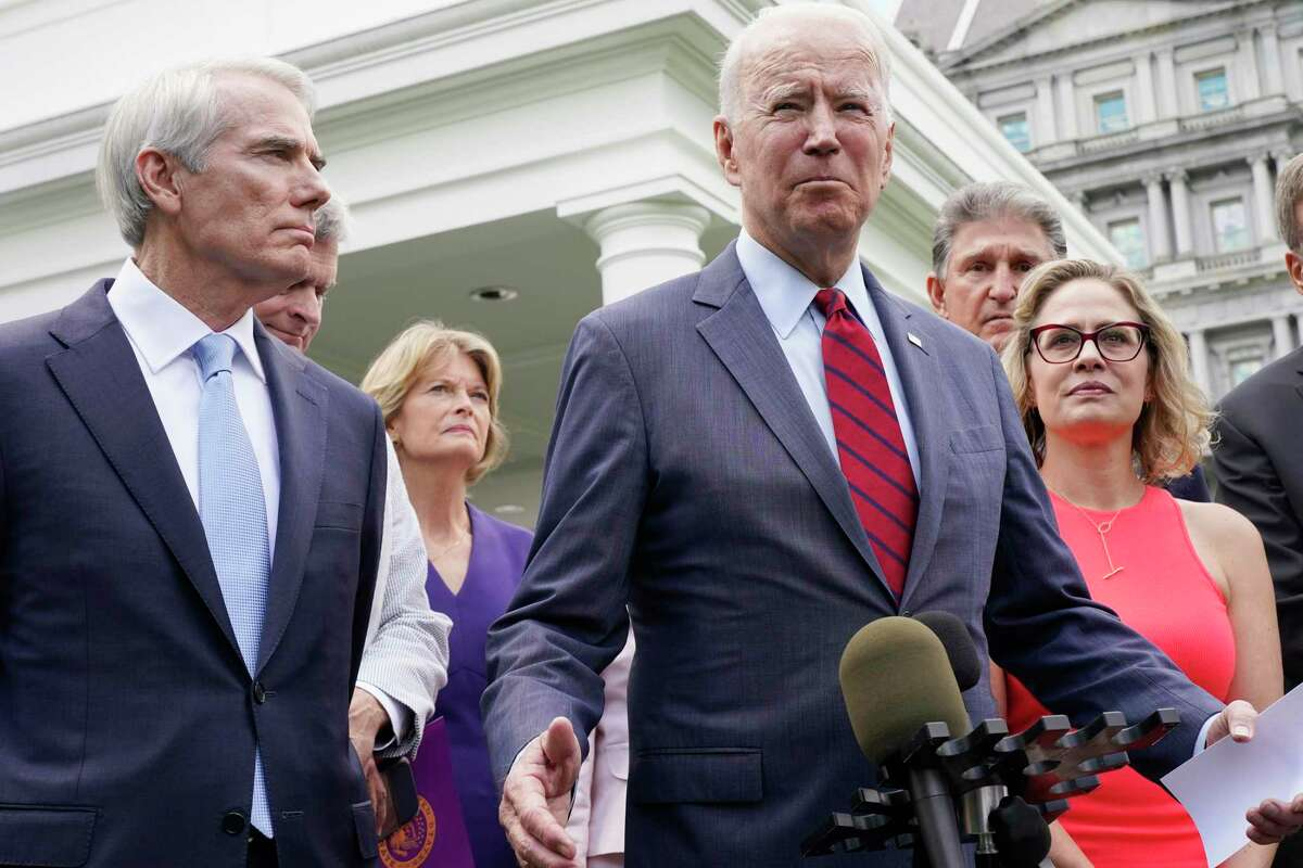 President Joe Biden, with a bipartisan group of senators, speaks last month outside the White House. Republicans have nothing to gain by backing Biden's infrastructure deal.