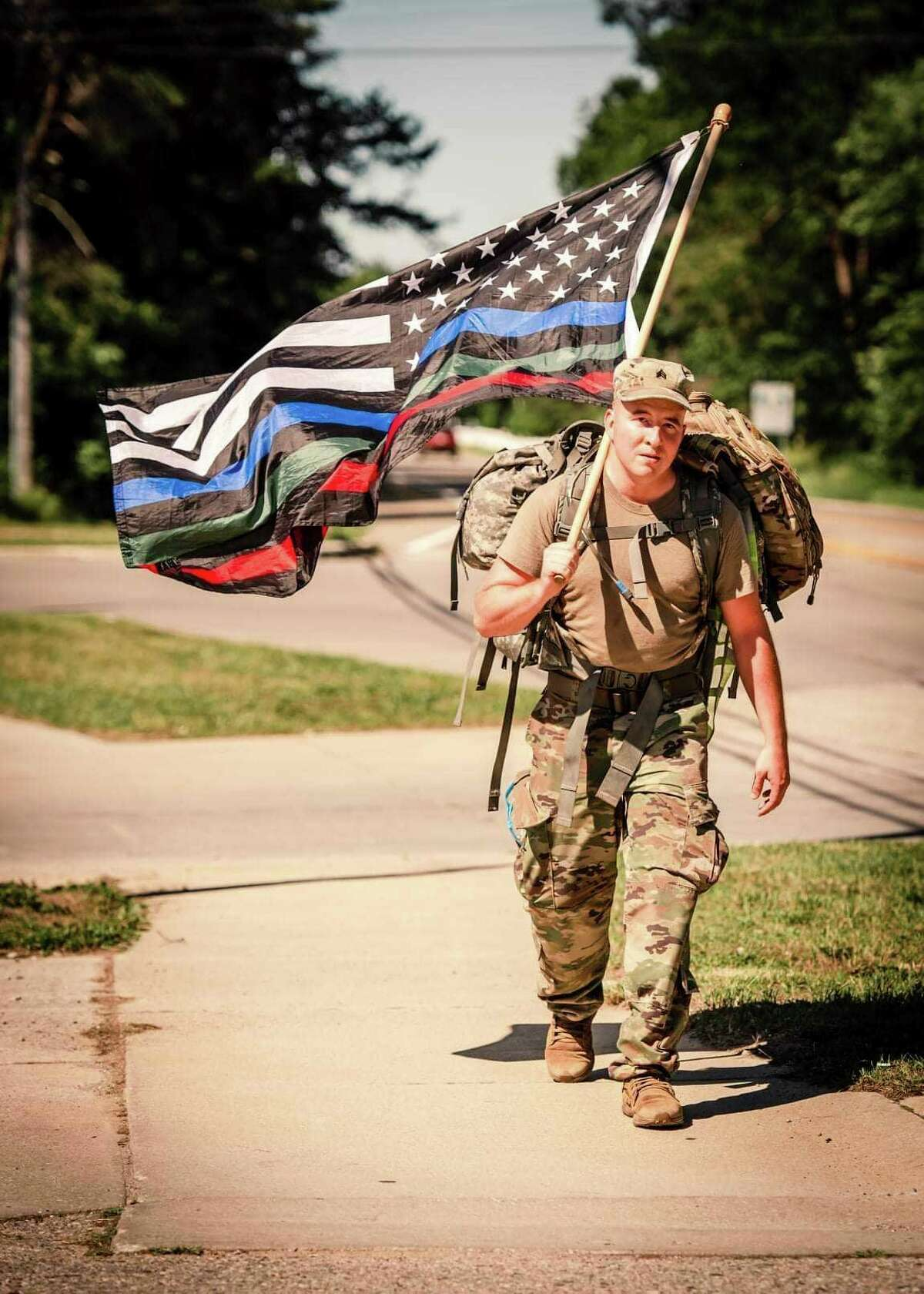 Mike Faupel walks along M-25 on the west side of the Thumb July 2 in support of veterans and first responders.(Mary Rose Jacobi Photography/Courtesy Photo)