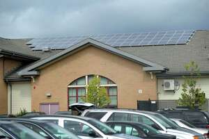 Solar arrays, installed on the roof, are used at Ellsworth Avenue School in Danbury, Conn., Friday, Sept. 13, 2013.