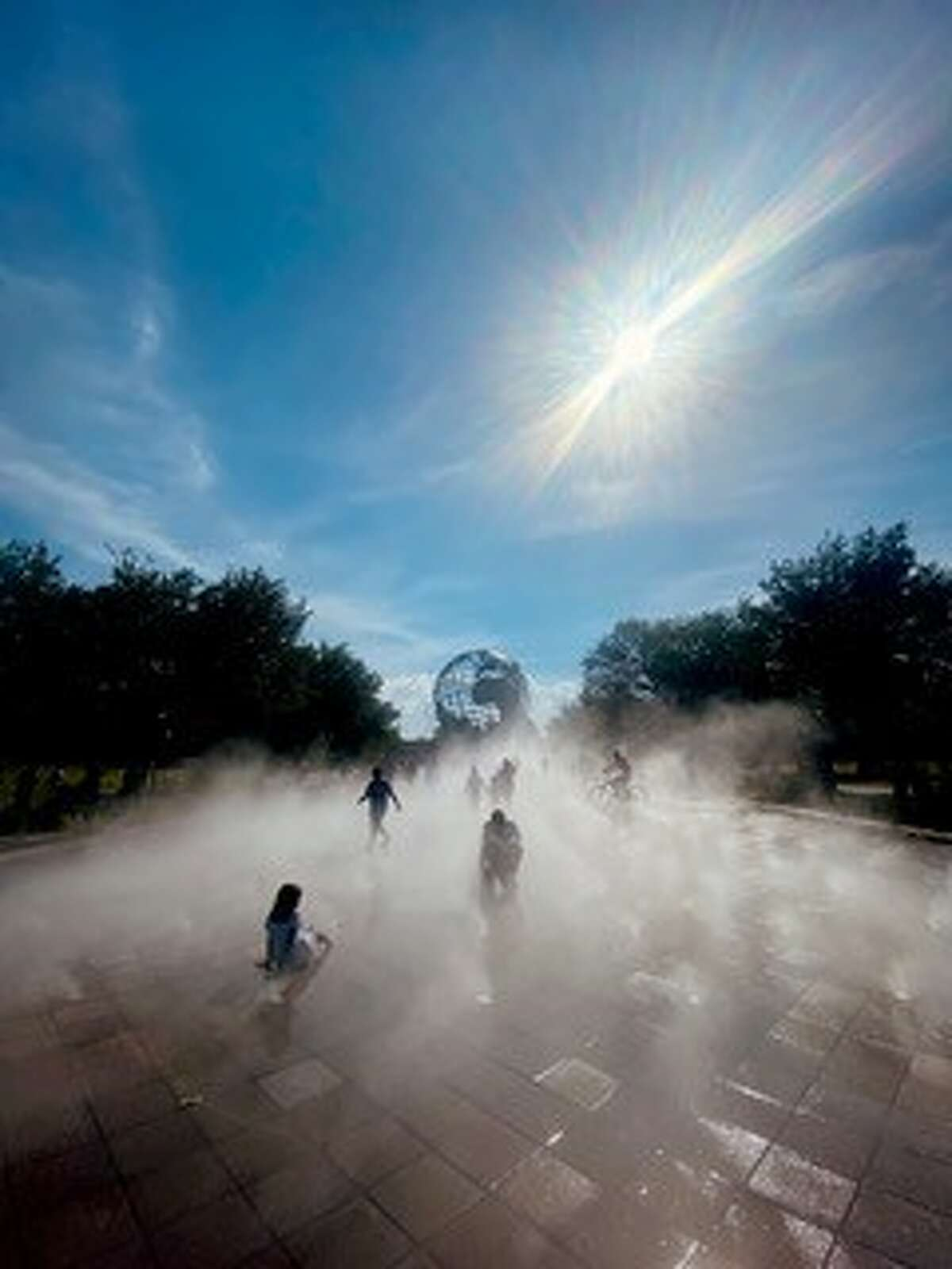 Here is a picture of people staying cool at the new mist pad in Flushing Meadows Corona Park yesterday, June 27 taken by Mary Rose Kaddo, a Troy transplant.