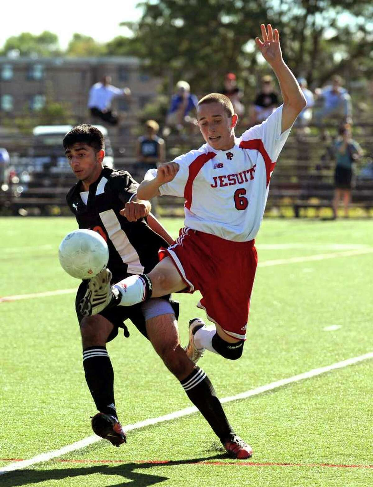Fairfield Prep's #6 Pat Connolly, right, leaps in to intercept the ball from Shelton's #19 Jawaad Qureshi, during soccer action at Fairfield University in Fairfield, Conn. on Tuesday September 14, 2010.