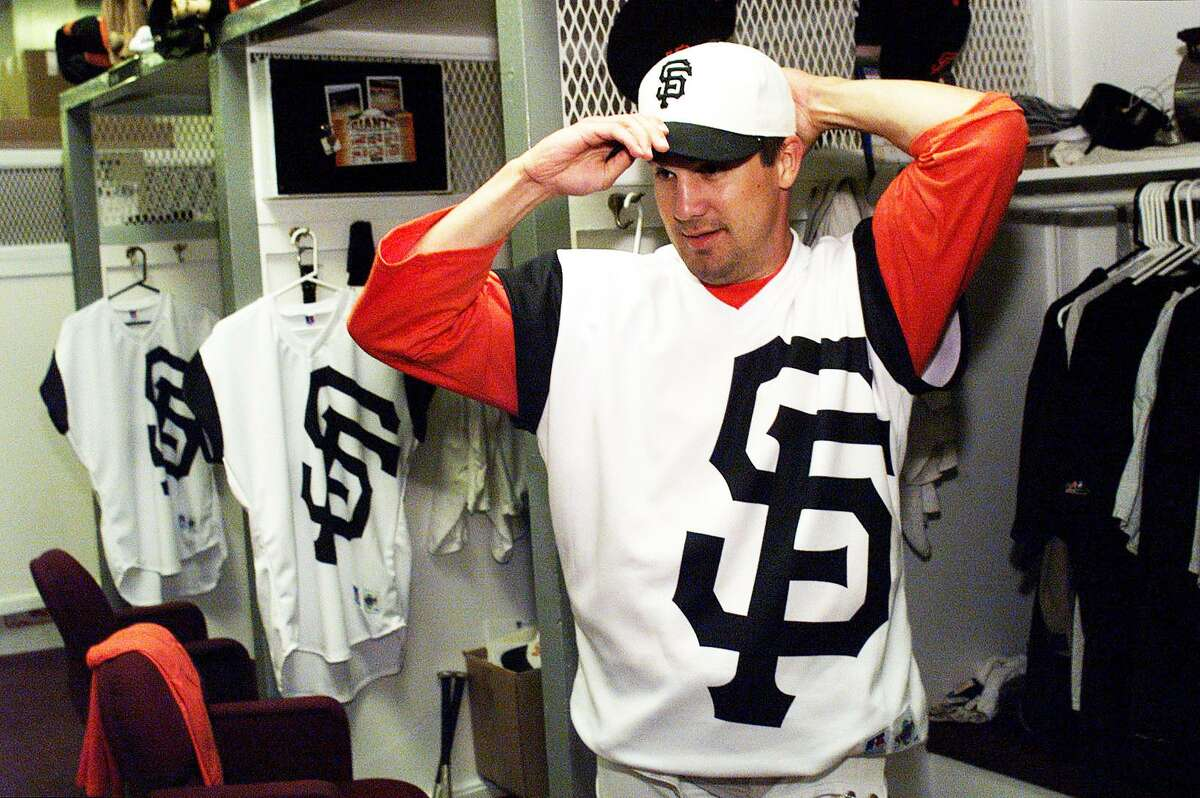 """Relief pitcher Chris Brock poses in a San Francisco Giants """"Turn Ahead the Clock"""" uniform in 1999."""