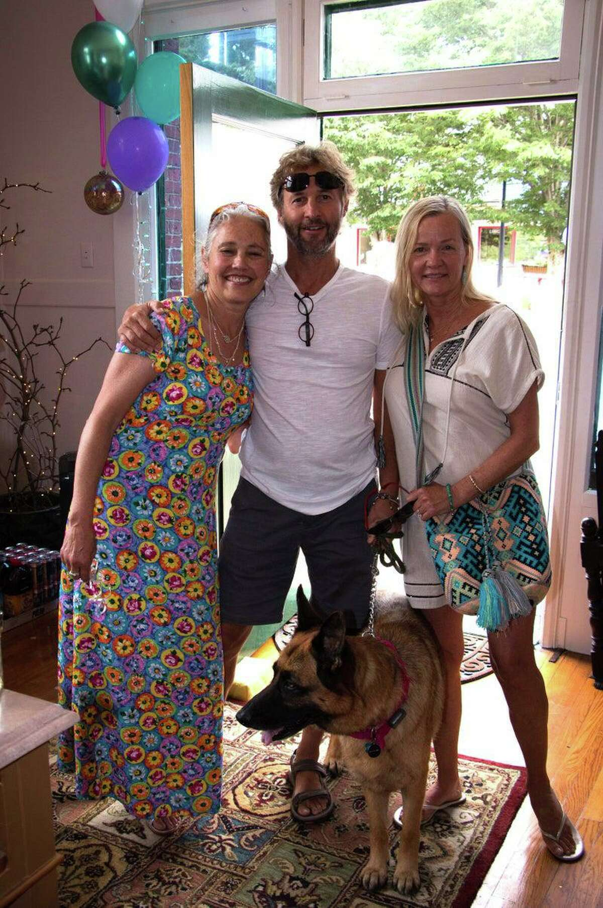 Healing Nest, a new wellness center, opened June 26 in Norfolk. From left are owner Dianna Hofer, her brother David Mullane and his wife, Kristin Scott, with their dog Lua.