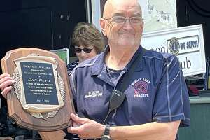 Members of the Stanwood Lions Club honored Dan Deyo with a service award plaque for 53 years of service with the Morley Area Fire Department.