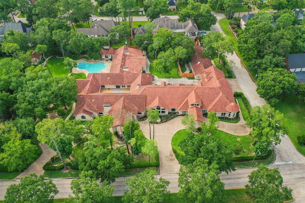 A listing photo shows the home for sale at 8902 Cypresswood Drive in Spring.