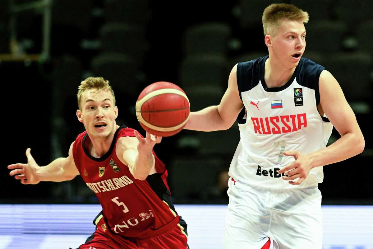 Russia's Anton Kardanakhisvili (R) fights for the ball with Germany's Niels Giffey during the FIBA Mens Olympic Qualifying Tournament match between Russial and Germany, on July 1, 2021, in Split. (Photo by Denis LOVROVIC / AFP) (Photo by DENIS LOVROVIC/AFP via Getty Images)