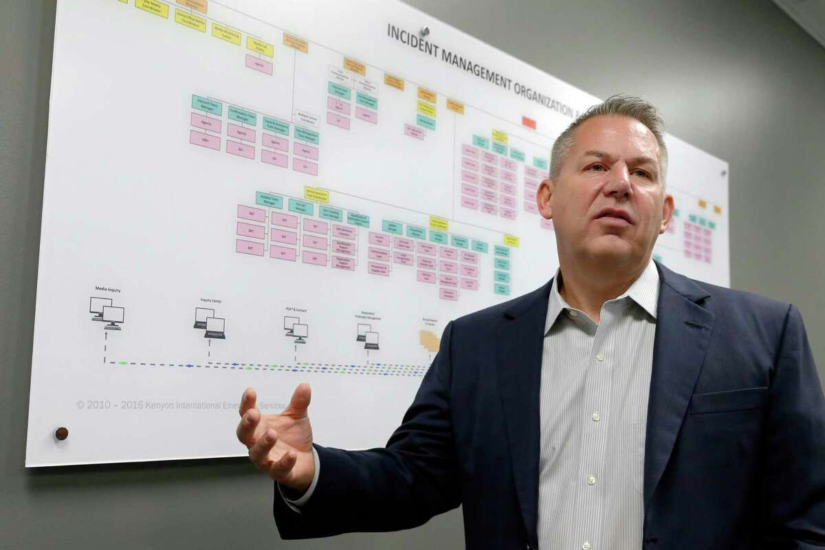 Robert A. Jensen, Chairman of Kenyon International Emergency Services, explains the operations as outlined in an organizational flow chart for the company in a conference room at the company headquarters Monday, May 10, 2021 in Spring, TX. The company travels the globe to assist in the family related victim services of disasters.