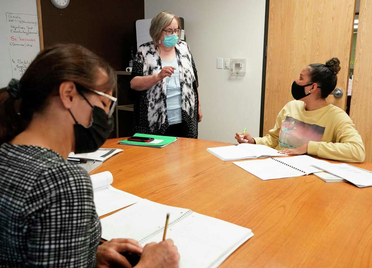 Student Alba Montealegre, left, teacher Ruth McDonald and student Paola Molina, right, are shown during the ESL Intermediate class at Memorial Assistance Ministries, 2424 Wilcrest, Tuesday, June 22, 2021 in Houston.