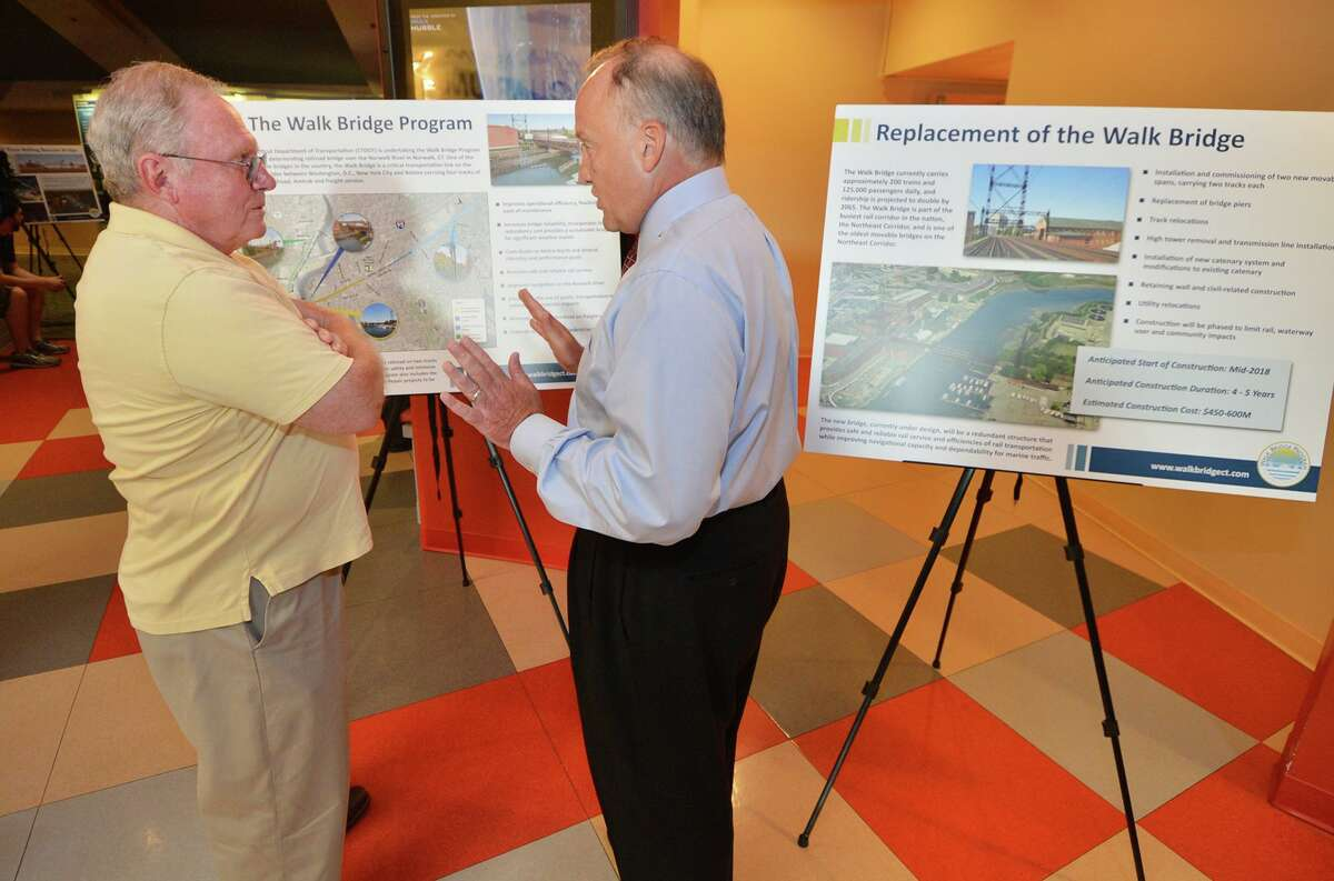 Joe Schnierlein talks with ConnDOT Project manager Arthur DiCesare about the Walk Bridge construction project during an informational meeting at The Maritime Aquarium in Norwalk Conn. on Tuedsay August 16, 2016
