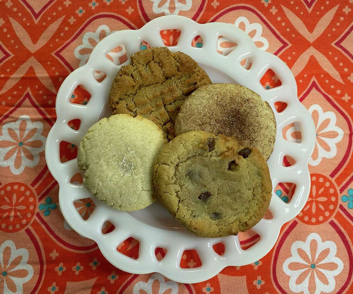 Cookie Cab 's top sellers are, clockwise from bottom right, chocolate chip, sugar, peanut butter and snickerdoodle.