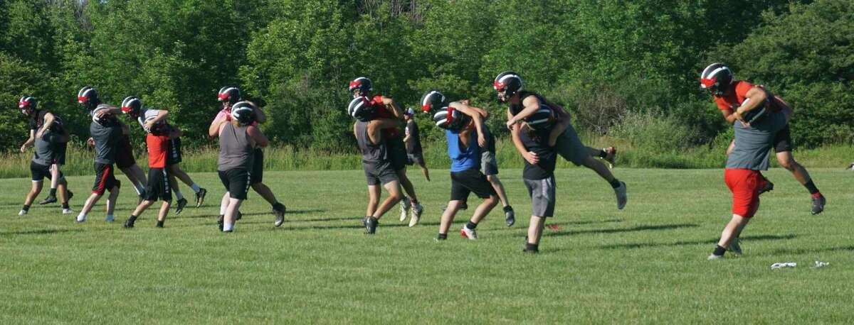 Members of the Reed City football team work on their form during a recent practice. (Pioneer file photo)