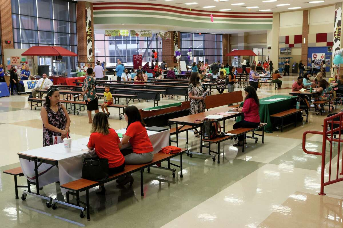 People complete applications and interview for available positions at the Judson ISD Job Fair at Judson High School on Wednesday, June 23, 2021. Judson ISD was accepting applications and giving same-day interviews for teachers, teacher aides, substitutes, bus drivers, child nutrition, custodians, maintenance and Adventure Club aides.