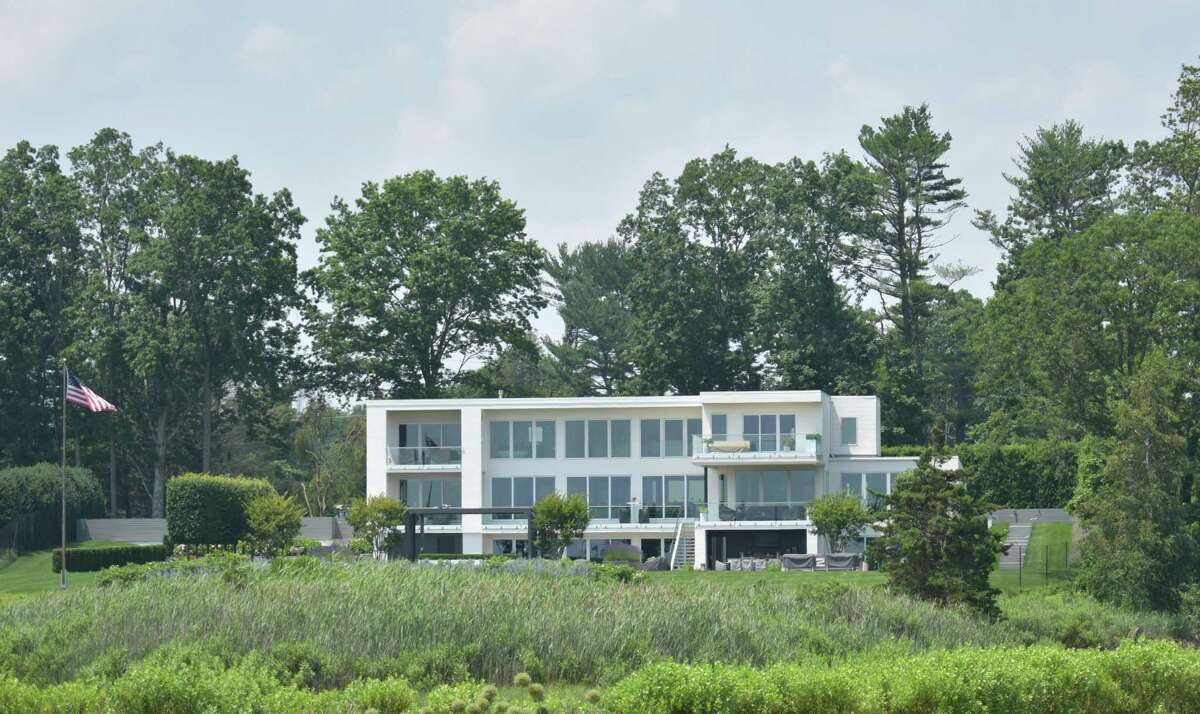 A Gray Lane home in Westport, Conn., which sold for $10 million in late June 2021, $900,000 less than what the property's prior owner sought last September but about $4.4 million more than its purchase price after it was built in 2018.